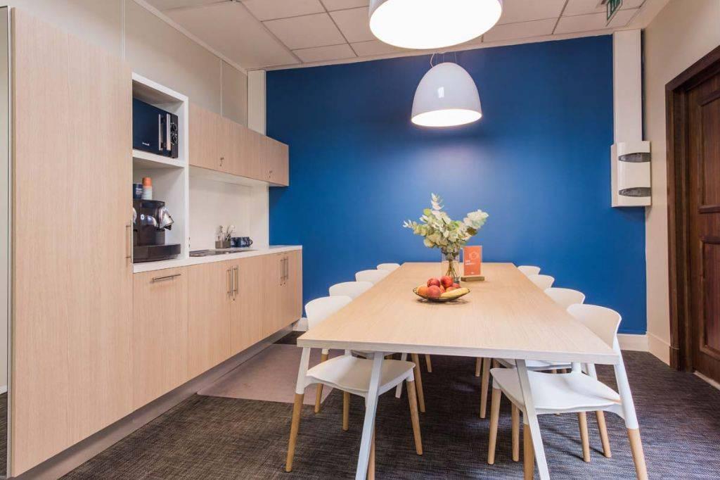 Blue wall in this office space